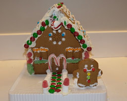 Service Club Delivers Gingerbread Houses For Habitat For Humanity Raffle
